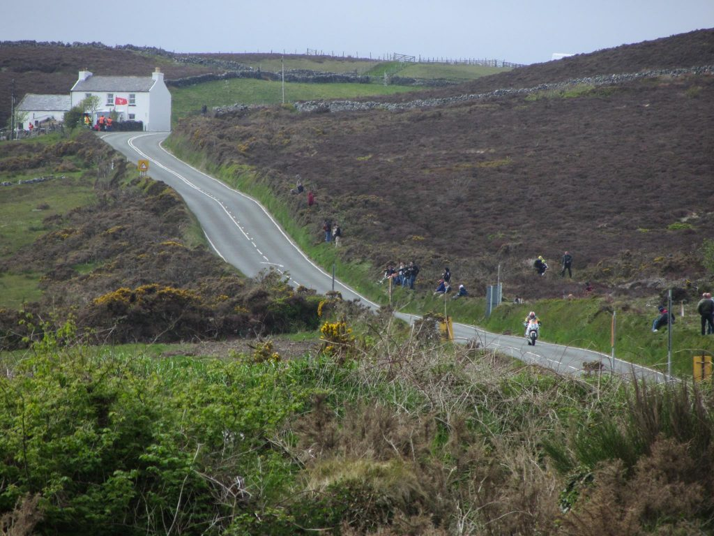 View over rolling hills of the Isle of Man TT riders